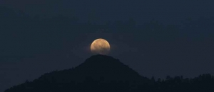 Photos of full moon in the mountain